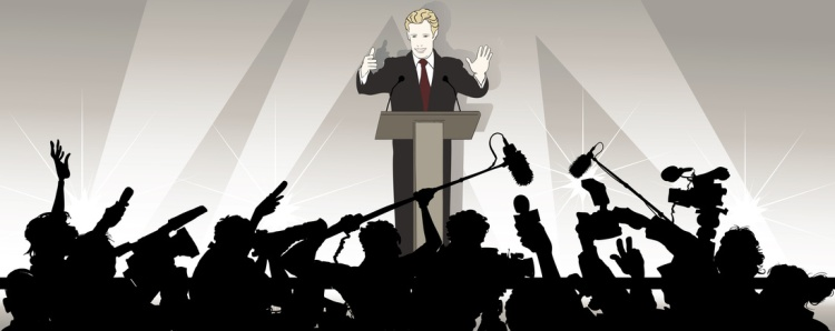 speaker addresses an audience in a political campaign