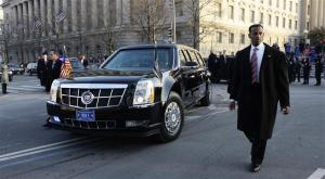 U.S. Secret Service officers escort the presidential limousine down Pennsylvania Avenue enroute to the White House